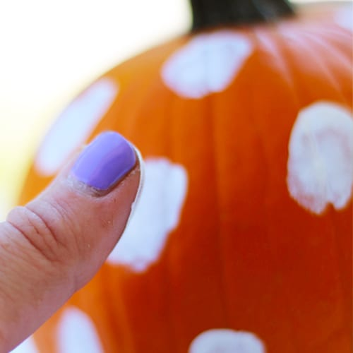thumbprints with paint on pumpkin